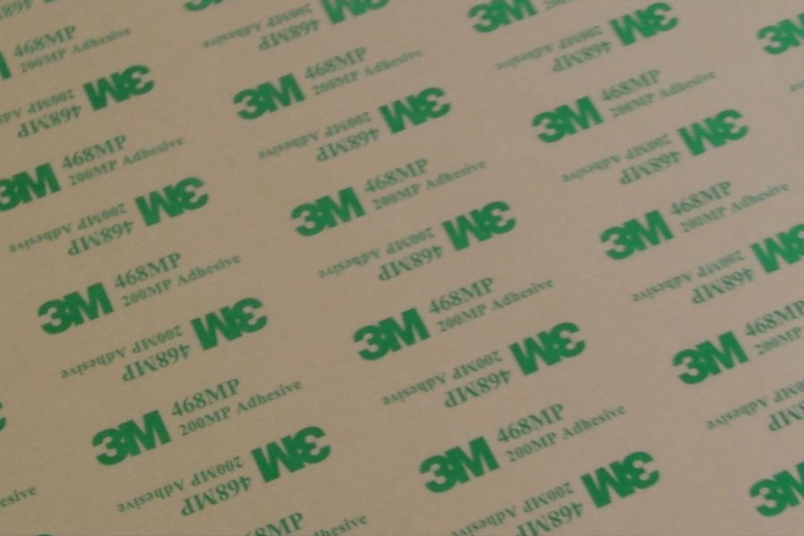 adhesive backing laminates